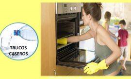 Como limpiar el horno con vinagre y bicarbonato de soda para evitar limpiadores abrasivos.